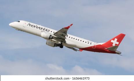 STUTTGART AIRPORT, STUTTGART, GERMANY - September 16, 2019: Helvetic Airways Embraer ERJ-190LR (HB-JVV) taking off on September 16, 2019 at Stuttgart Airport, Stuttgart, Germany.
