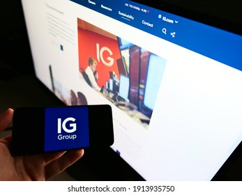 Stuttgart, Germany - 01-31-2021: Person holding cellphone with logo of British financial services company IG Group Holdings Plc. on screen with website. Focus on phone display. Unmodified photo.