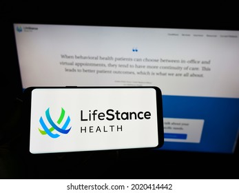 Stuttgart, Germany - 08-01-2021: Person holding cellphone with logo of US health care company LifeStance Health Inc. on screen in front of business webpage. Focus on phone display. Unmodified photo.