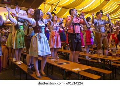 STUTTGART, GERMANY, 25 SEPTEMBER 2016. Volksfest in Stuttgart.  People dance in the Beer Tent.