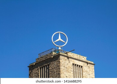 STUTTGART, GERMANY - Apr 20, 2019:   The tower of Stuttgart Central Station with the rotating Mercedes-Benz logo in Stuttgart. The building is one of Stuttgart's main landmarks.