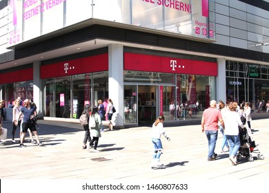 STUTTGART, GERMANY - Apr 20, 2019:  T-Mobile store with people. T-Mobile is the brand name used by the mobile communications subsidiaries of the German telecommunications company Deutsche Telekom