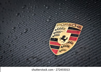STUTTGART GERMANY - APRIL 04, 2015 : Porsche emblem carbon. Ferdinand Porsche founded the company in 1931.