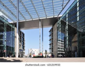Stuttgart, Germany - April 21, 2017: Modern business center in Stuttgart. Glass buildings and transparent canopy with columns.