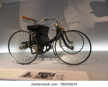 "STUTTGART, GERMANY - APRIL 25, 2014: Daimler Motor-Quadricycle ""Stahlradwagen"" (""steel wheel carriage""). Permanent exhibition in Mercedes-Benz museum."