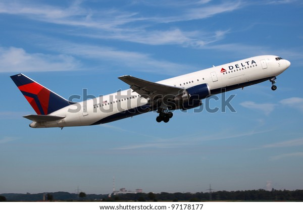 STUTTGART, GERMANY - AUGUST 20, 2011: A Delta Air Lines Boeing 767 takes off on August 20, 2011 in Stuttgart, Germany. Delta is the world's largest airline with 111 million passengers in 2010.