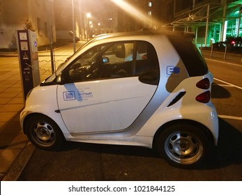 Stuttgart, Germany - February 10, 2018: Electric Smarts of car sharing company Car2Go are being charged overnight at chargers in the city of Stuttgart overnight.