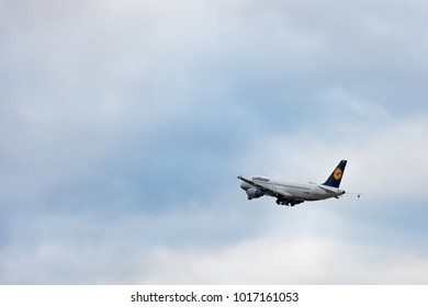 Stuttgart, Germany - February 3, 2018: Airbus airplane A320-211 from Lufthansa while flying - blue sky with clouds