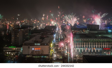 STUTTGART, GERMANY - JANUARY 1, 2015: View along the main shopping street, known as Koenigstrasse. In the center of the city, the citizens welcome the new year with individual fireworks.