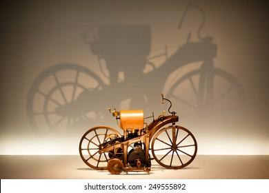 "STUTTGART, GERMANY - JANUARY 31, 2015: Museum ""Mercedes-Benz-Welt"" Replica of the Daimler Reitwagen, first motorcycle of the world"