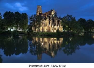 Stuttgart, Germany. Johanneskirche (St John's Church) on the Feuersee (Fire Lake) in dusk. The church was built in 1864-1876.