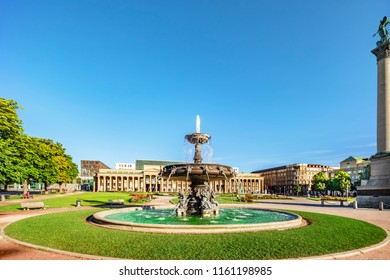 STUTTGART, GERMANY - July 12, 2018: Stuttgart downtown castle square with fountain in the center of the photo.