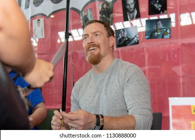 STUTTGART, GERMANY - JUN 30th 2018: Toby Stephens (Black Sails, Lost in Space) signing autographs for fans at Comic Con Germany Stuttgart, a two day fan convention