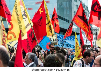 STUTTGART, GERMANY - June 15, 2013: People protest against the Stuttgart21 railway project and unite with people demonstrating against the happenings in Turkey on June 15, 2013 in Stuttgart, Germany.