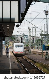 STUTTGART, GERMANY - June 15, 2013: Main railway station and incoming train at S21 construction site on June 15, 2013 in Stuttgart, Germany. S21 is one of the most expensive railway projects ever