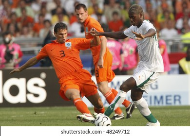 STUTTGART, GERMANY - JUNE 16:  Khalid Boulahrouz of Holland (l) tackles Romaric of Cote d'Ivoire during a World Cup  match June 16, 2006 in Stuttgart, Germany. Editorial only.  No mobile device usage.