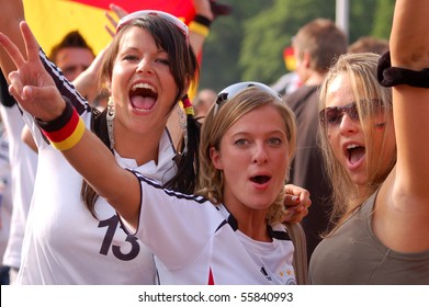 STUTTGART, GERMANY - JUNE 17: Worldcup fans celebrating their teams victory at a FIFA fan gathering in Stuttgart, Germany on June 17th 2006