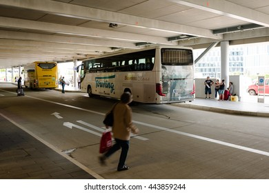 Stuttgart, Germany - June 25, 2016: Two long distance busses in the new Stuttgart Central Bus Station at the airport. Since the monopoly of the Deutsche Bahn (German railroads) ended in 2013, a lot of