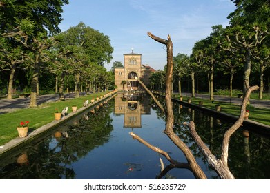 Stuttgart, Germany - MAI 13, 2015: the Zoo Wilhelma in Stuttgart. Artificial pond with aquatic plants. Ancient palace in the background.