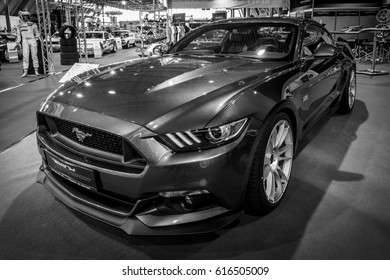 """STUTTGART, GERMANY - MARCH 03, 2017: Pony car Ford Mustang GT V8 Fastback Coupe, 2016. Black and white. Europe's greatest classic car exhibition """"RETRO CLASSICS"""""""