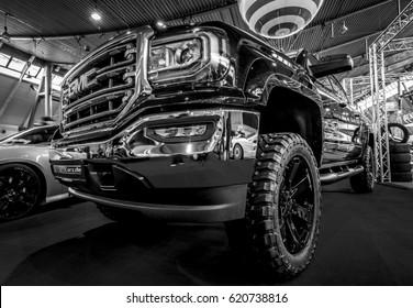 "STUTTGART, GERMANY - MARCH 03, 2017: Heavy-Duty pickup truck GMC Sierra 1500 Crew Cab SLT, 2017. Black and white. Europe's greatest classic car exhibition ""RETRO CLASSICS"""