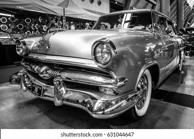 "STUTTGART, GERMANY - MARCH 03, 2017: Mid-size luxury car Ford Mainline, 1953. Black and white. Europe's greatest classic car exhibition ""RETRO CLASSICS"""