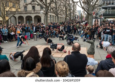 STUTTGART, GERMANY - MARCH 04, 2017: Performance of a street youth dance group on the central historical street Koenigstrasse (King Street).