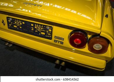 "STUTTGART, GERMANY - MARCH 04, 2017: Fragment of sports car Ferrari 328 GTS. Rear view. Europe's greatest classic car exhibition ""RETRO CLASSICS"""