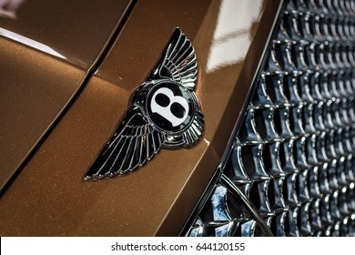 "STUTTGART, GERMANY - MARCH 04, 2017: Hood ornament of large luxury crossover SUV Bentley Bentayga, 2016. Europe's greatest classic car exhibition ""RETRO CLASSICS"""
