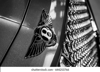 "STUTTGART, GERMANY - MARCH 04, 2017: Hood ornament of large luxury crossover SUV Bentley Bentayga, 2016. Black and white. Europe's greatest classic car exhibition ""RETRO CLASSICS"""