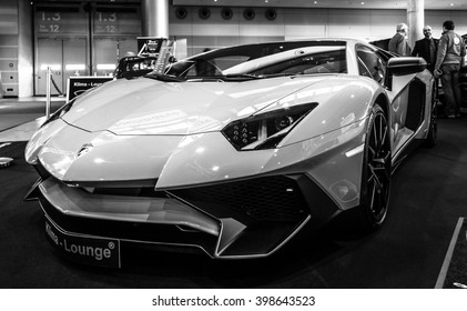 "STUTTGART, GERMANY - MARCH 17, 2016: Mid-engined sports car Lamborghini Aventador LP 750-4 SuperVeloce, 2016. Black and white. Europe's greatest classic car exhibition ""RETRO CLASSICS"""