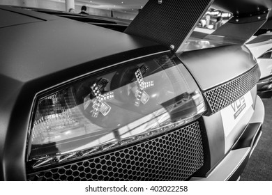 "STUTTGART, GERMANY - MARCH 17, 2016: The rear brake lights of sports car Lamborghini Murcielago PL650R, 2007. Black and white. Europe's greatest classic car exhibition ""RETRO CLASSICS"""
