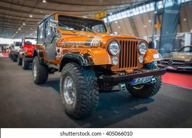 "STUTTGART, GERMANY - MARCH 17, 2016: Off-road Jeep Wrangler Renegade, 1994.Tilt-Shift. Europe's greatest classic car exhibition ""RETRO CLASSICS"""