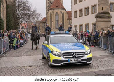 STUTTGART, GERMANY - MARCH 5: police patrol car and four policemen on horseback open the parade. Shot under light rain at Carnival parade in city center on march 5, 2019 Stuttgart, Germany
