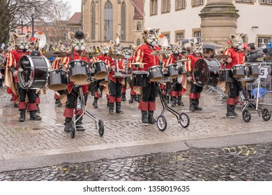 STUTTGART, GERMANY - MARCH 52019: marching band with players dressed up as cats in parade under light rain.  Shot at  Carnival parade in city center on march 5, 2019 Stuttgart, Germany