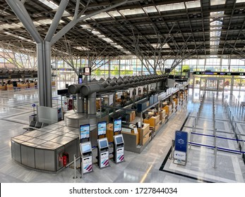 Stuttgart, Germany - May 05, 2020: Coronavirus outbreak: Empty check-in desks at the airport terminal due to pandemic of coronavirus and airlines suspended most of their flights in Stuttgart, Germany.