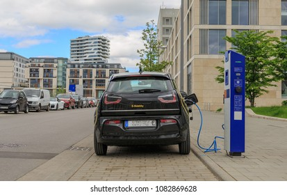 STUTTGART, GERMANY - MAY 1, 2018: Electric car at a charging station in Stuttgart