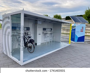 Stuttgart, Germany - May 12, 2020: Modern electric bike charging station. Green technology concept by manufacturer ChargingCube, a solar powered container with several cables providing free of charge