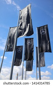 Stuttgart, Germany – May 31, 2019: Mercedes-Benz Flags in front of the Mercedes-Benz Museum at Stuttgart. It is located in Bad Cannstatt and part of the Mercedes Benz Welt.