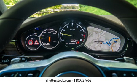 STUTTGART, GERMANY - MAY 8, 2018: Photo of the dashboard of Porsche Panamera 4 e-hybrid plug-in car, with a navigation map on.