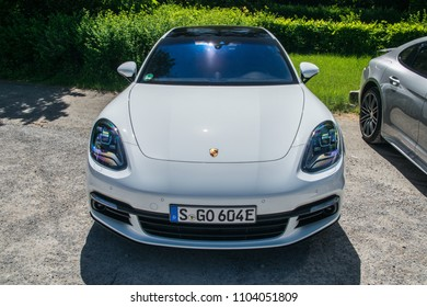 STUTTGART, GERMANY - MAY 8, 2018: Porsche Panamera 4 e-hybrid parked outside during a test-drive event. Panamera 4 e-hybrid eqipped with a 14.1-kWh battery and electric 136-hp motor/generator.