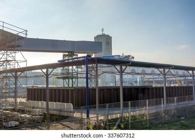 Stuttgart, Germany - November 1, 2013: Construction site Stuttgart 21. View of the water management, old main railway station tower in the background.