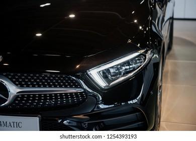 STUTTGART, GERMANY - OCTOBER 16, 2018: Mercedes Museum. Gorgeous black modern car. Particle view. Front part.
