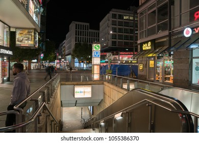 STUTTGART, GERMANY - SEPTEMBER 12;  night street and building scene, entrance and escalator down to underground station in Marienstrasse September 12 2017 Stuttgart Germany