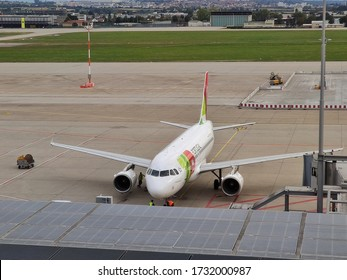 Stuttgart, Germany - September 22, 2019: At the airport of Stuttgart (STR) - an airplane Airbus A320 from TAP Portugal Airline in parking position with working ground force stuff.