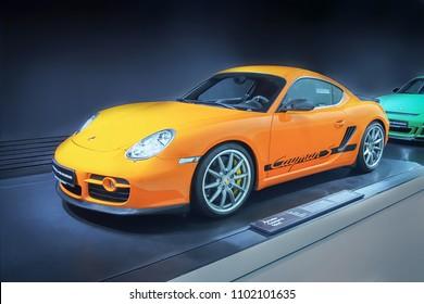 STUTTGART, GERMANY-APRIL 7, 2017: Orange 2008 Porsche Cayman S Sport in the Porsche Museum
