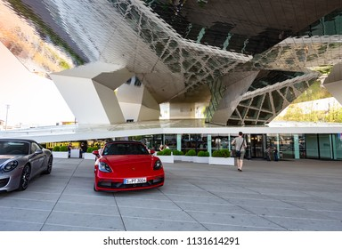 STUTTGART- GERMANY-MAY-17-2018:Porsche Museum and a Porsche dealer on October 3, 2012 in Stuttgart, Germany. Porsche is a German company with investments in the luxury automotive industry.