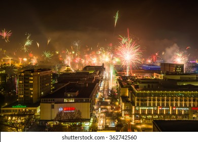 Stuttgart - January 1st, 2016, people are welcoming the new year with traditional fireworks. Long exposure shot from the main station tower over the city centre along the main shopping street.