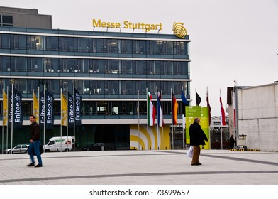 """STUTTGART - MARCH 18: Administrative Building of the new Stuttgart Trade Fair next to the Airport on March 18, 2011 in Stuttgart, Germany. Flags are promoting the current """"Invest"""" exhibition."""