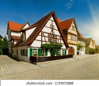 Stuttgart, old town in wine Metzingen region (Weinbaumuseum Metzingen), Germany. Motley colorful traditional german bavarian houses along street. Day cityscape with architecture blue sky and clouds.